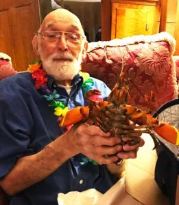 Grandpa Cook unwraps his lobsters